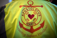 Stella Maris logo on the back of a worker's jacket